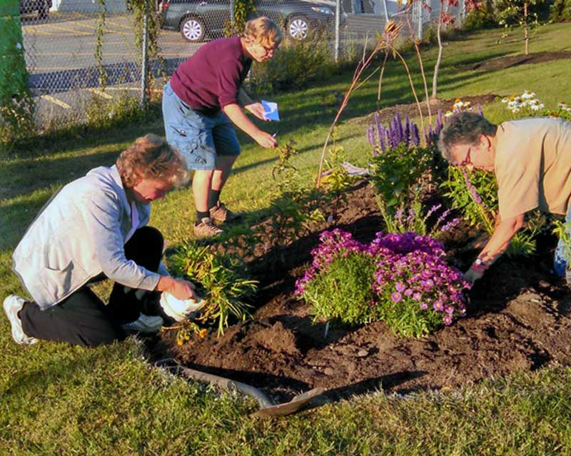 Susan McCloskey, Annie Wadleigh and Phyllis Reames helping to plant the first pollinator garden.  Photo by Donna Herczeg.