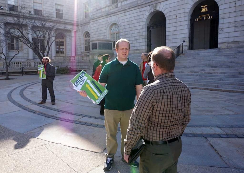 Tom MacMillan stumps for the $15 minimum wage initiative.