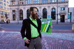 Asher Platts in Monument Square petitioning for a $15 minimum wage.