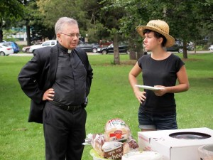 Fr. Mike Seavey and Meaghan Lasala at a free health care clinic hosted by the nurses union and Southern Maine Workers' Center.