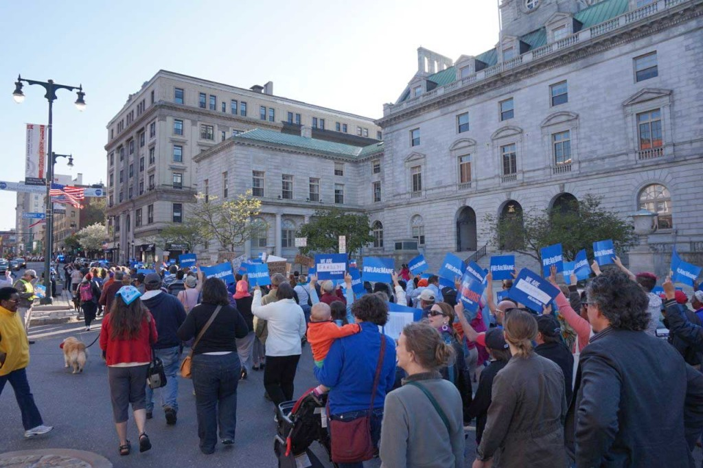 March moves past City Hall, growing in numbers.