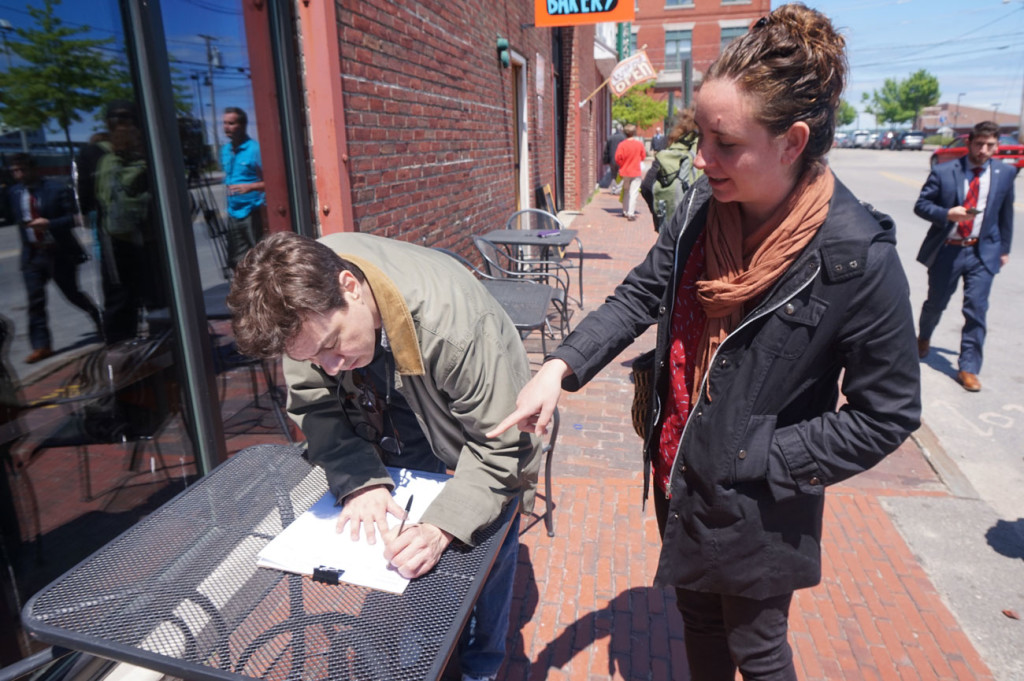 Brian Leonard of South Portland is among the first to sign to put a $12 minimum wage on the state ballot in 2016.