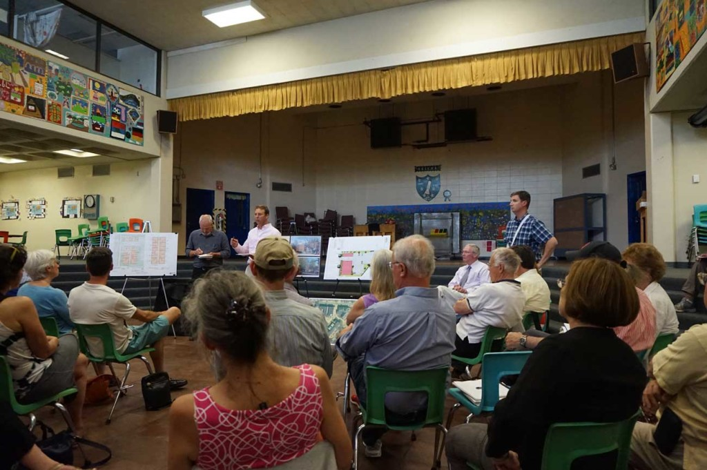 Avesta reps pitch their development to the neighborhood at Reiche Community School cafeteria.