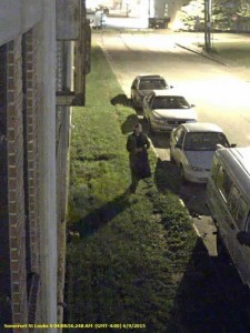 Security camera still of suspect in car burglary investigation.
