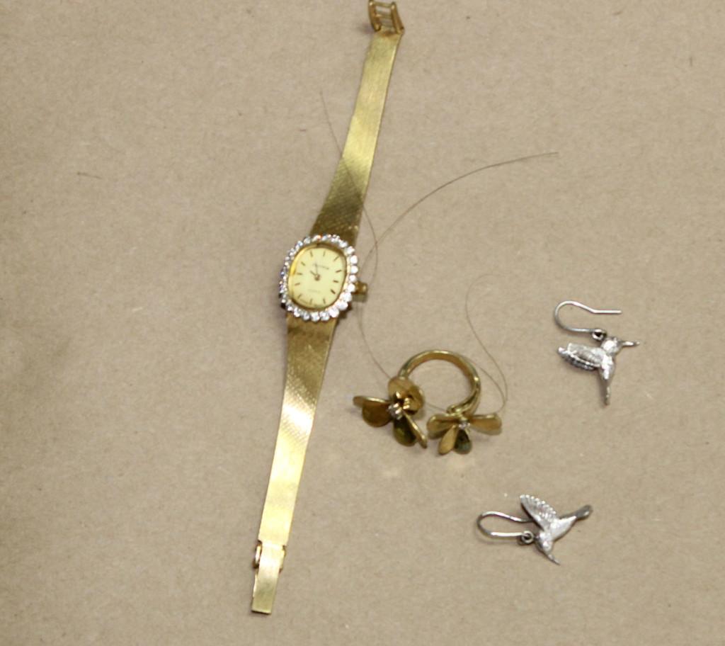 Jewelry found on  unidentified woman. Courtesy of Portland Police.