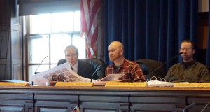Dave Marshall chairing a Transportation, Sustainability and Energy Committee hearing. Councilors Hinck and Donoghue also pictured.