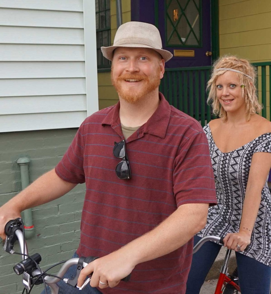 Dave Marshall and his wife Whitley on their tandem bike in front of their West End home.