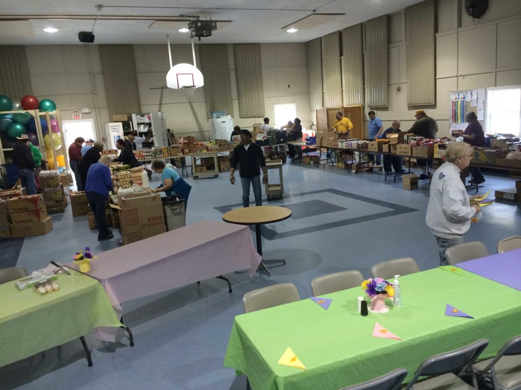 Volunteers prepare for clients at CrossWalk Community Outreach in Naples. Food banks are one way to get involved in your community, with plenty of local opportunities to volunteer.