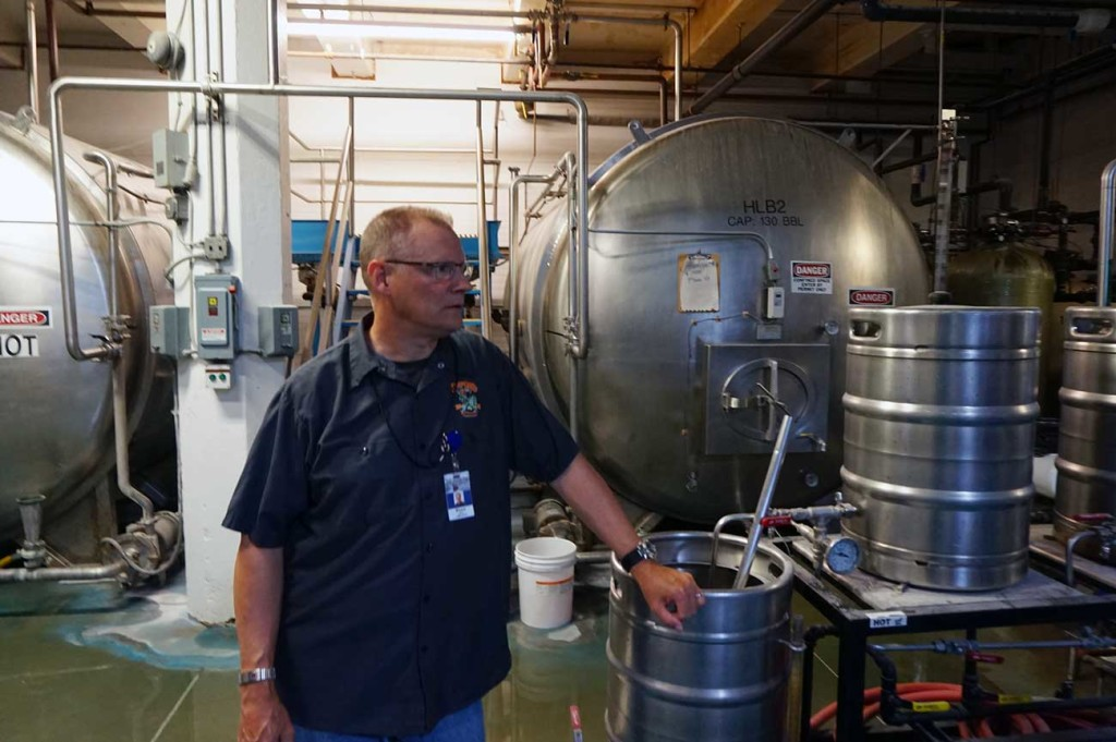 Bruce Elan giving a tour of the Shipyard brewery in the India Street neighborhood.