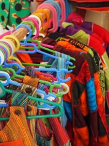 Long Goodbye: thrift shop clothing on rack
