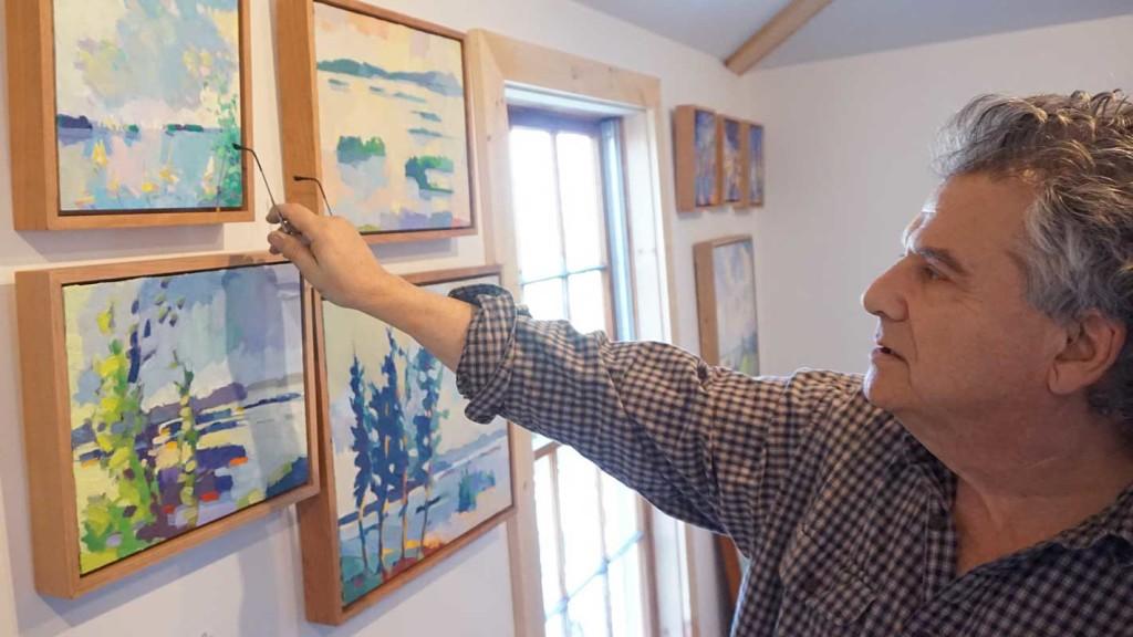 Henry Isaacs discusses work that hangs in his Brackett Street studio.