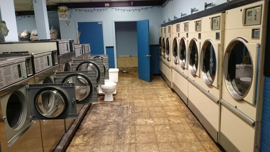 West End News: Soap Bubble Laundromat: Damage from sewer overflow