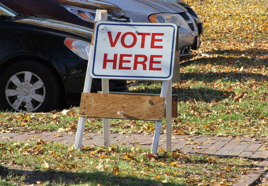 West End News - Vote here sign for how-to vote absentee or in person