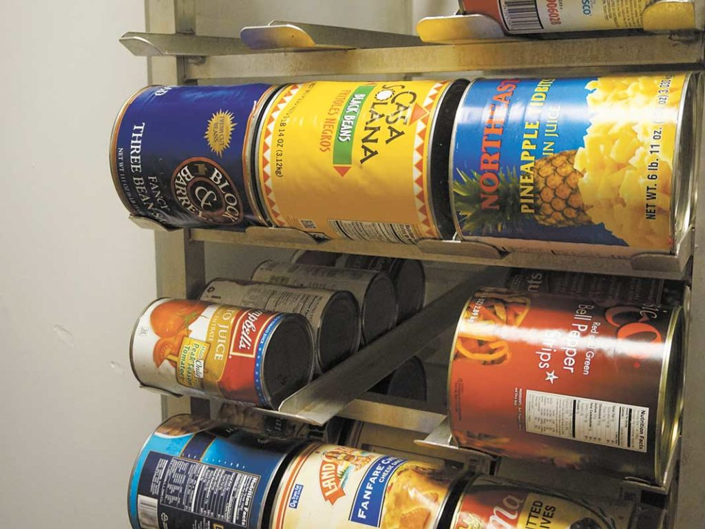 West End News - Giving Food _ cans stacked at Wayside