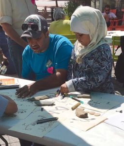West End News - Calligraphy - Ahmad Alzubaidi and daughter
