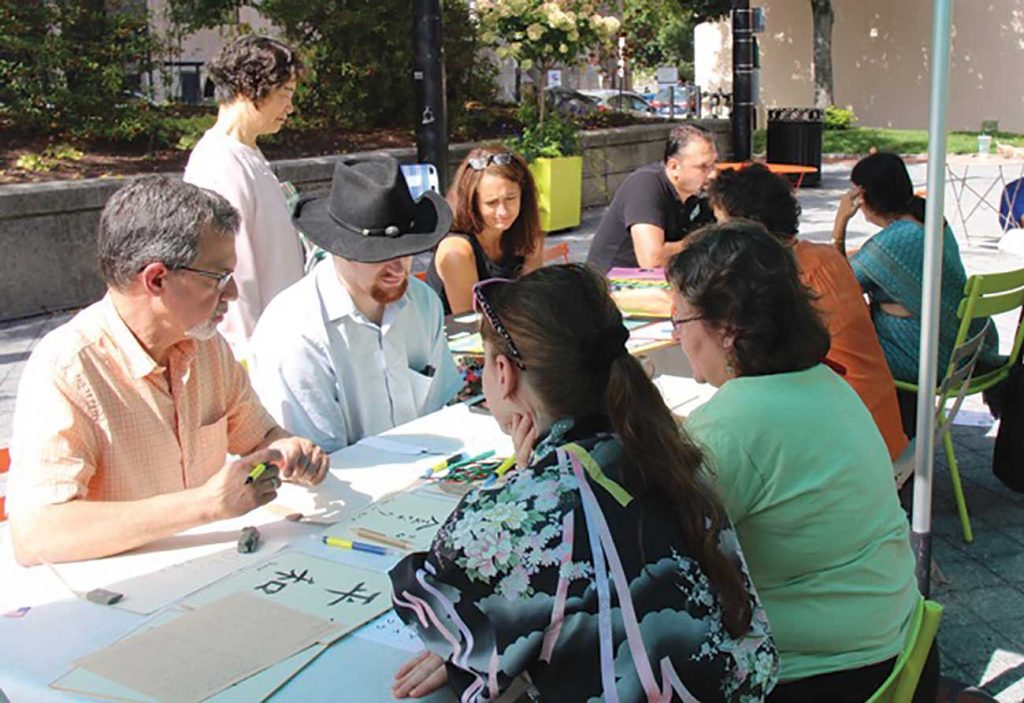 West End News - Calligraphy - Visitors learn Japanese calligraphy