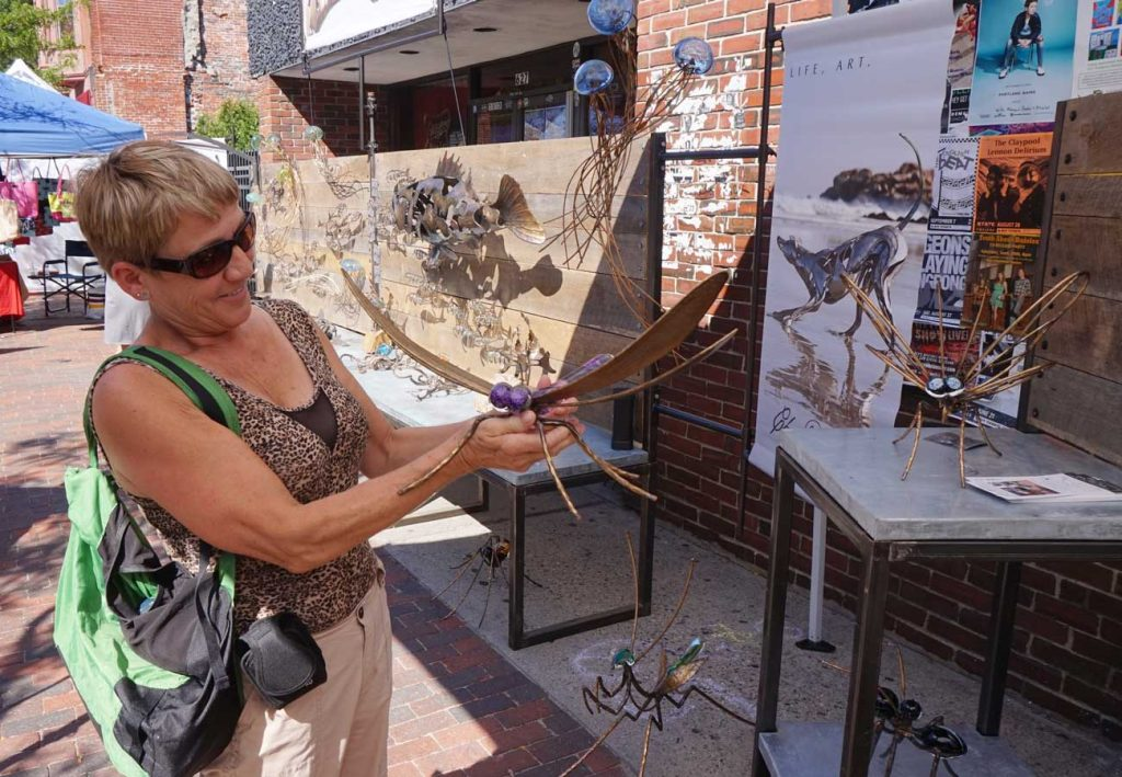West End News - Craft Show 2016 - Jasmine Ness with metal and glass dragon fly sculpture by Chris Williams