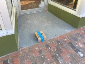 West End News - Disappearing packages - Amazon box in doorway