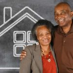 West End News - Aging in Place - Adobe Stock older couple and house on chalk board