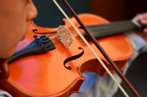 West End News - PCM - Child plays violin