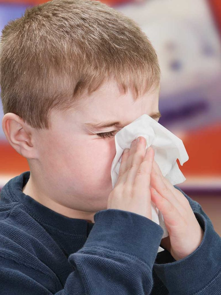 West End News - Flu Season Get Prepared - Child sneezing Adobe Stock