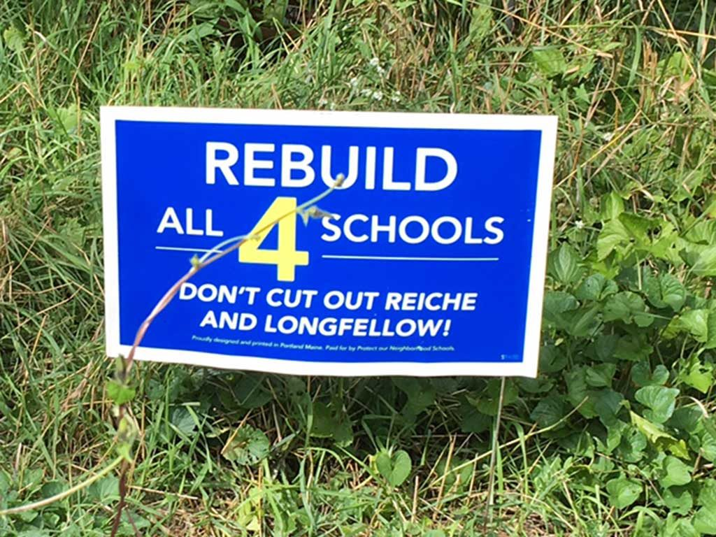 West End News - Rebuild All 4 Schools sign