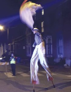 West End News - Halloween parade - stilt walker