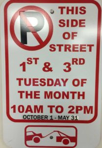 West End News - No Parking Sign with Decal