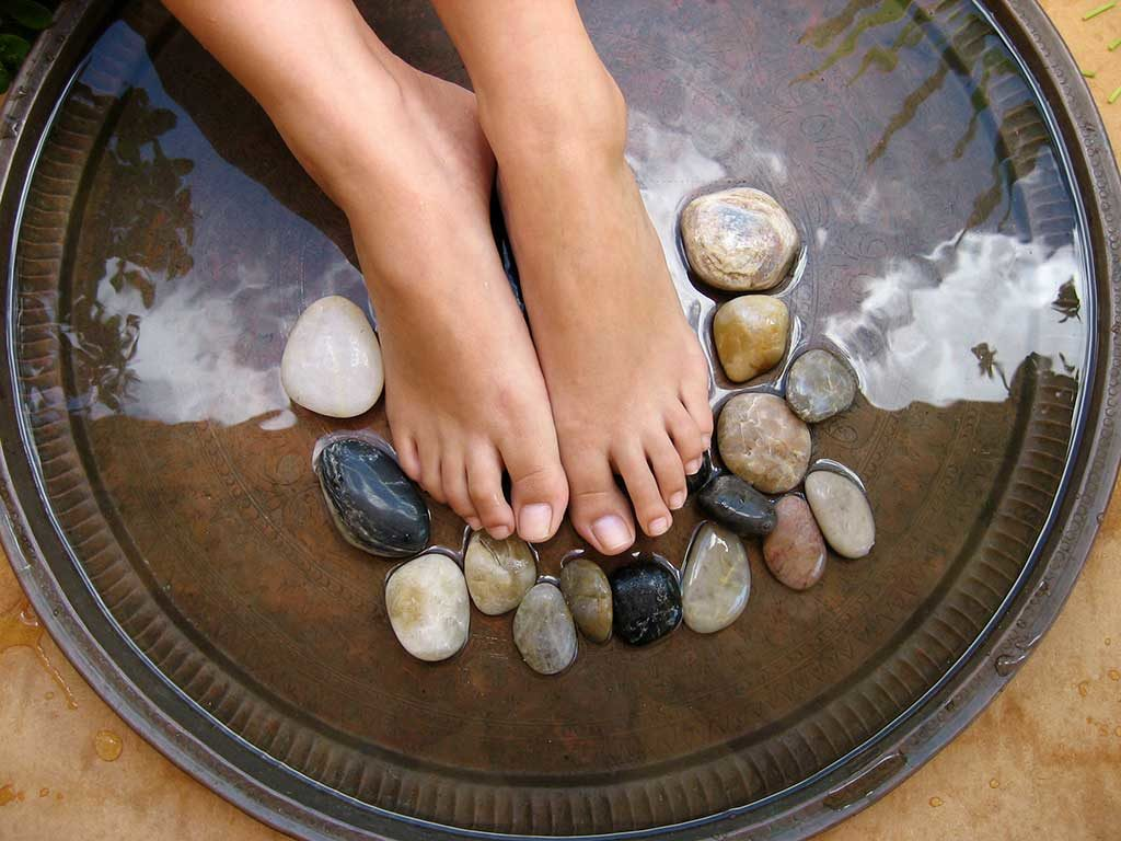 West End News - Foot soak, relax - Adobe Stock by Ye Liew