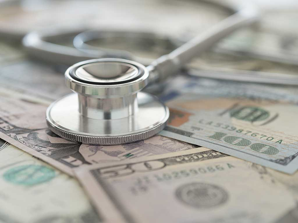West End News - The Cost of Health Care - image of stethoscope and cash