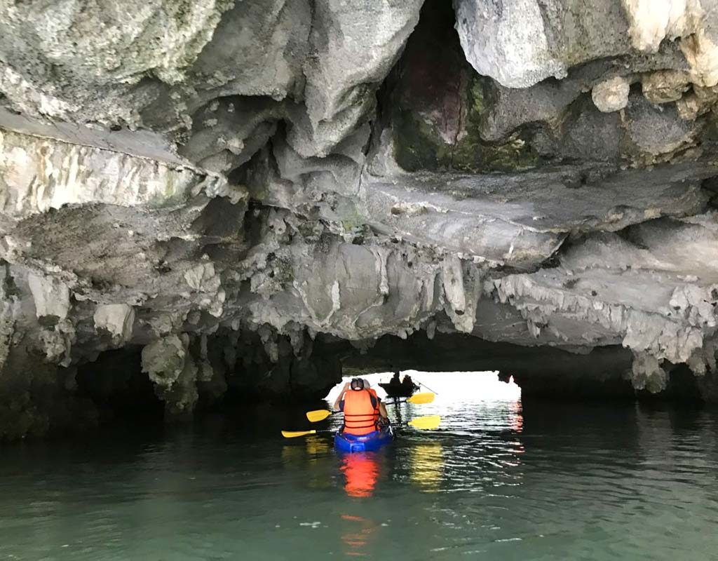 West End News - Kayaking among the caves of Halong Bay. - By Nancy Dorrans