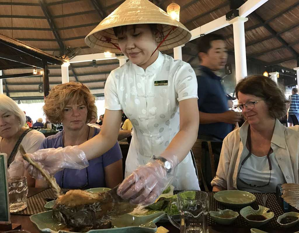 West End News - Nancy Dorrans samples elephant ear fish on thanksgiving in Vietnam