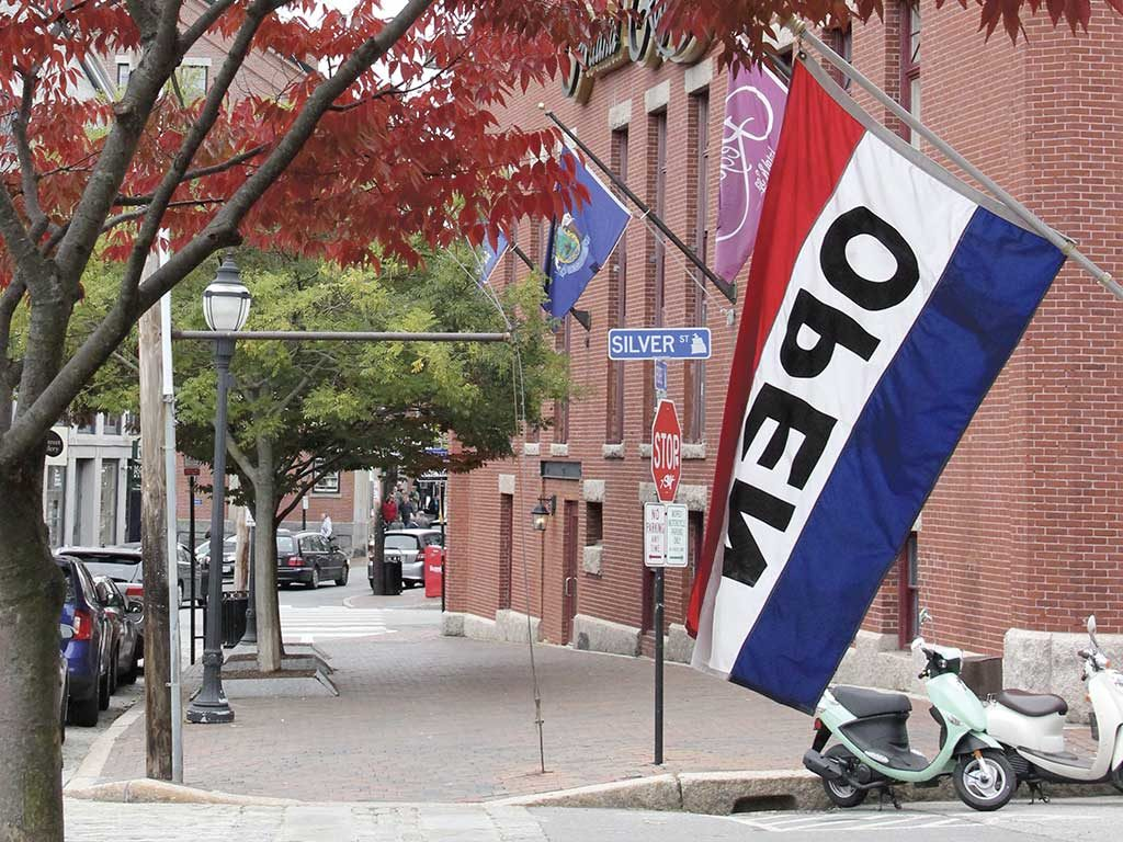 West End News - local business disruption - Open flag outside Old Port establishment