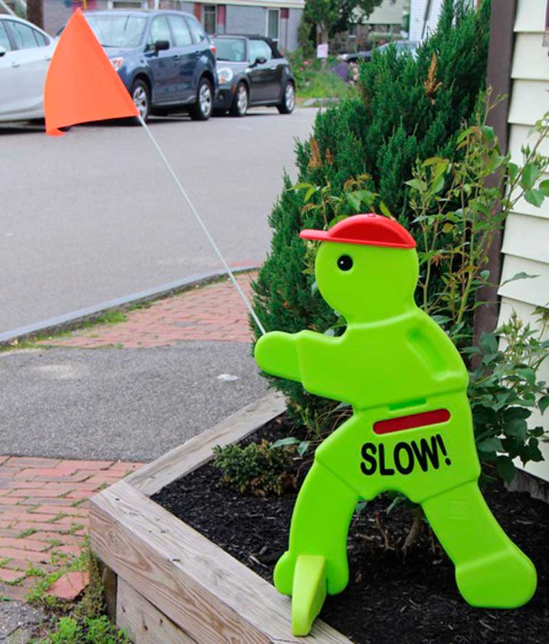 West End News - Slow Down Green Guy sign - Photo By Rosanne Graef
