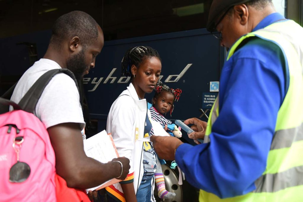 West End News - Asylum seekers board bus in San Antonio