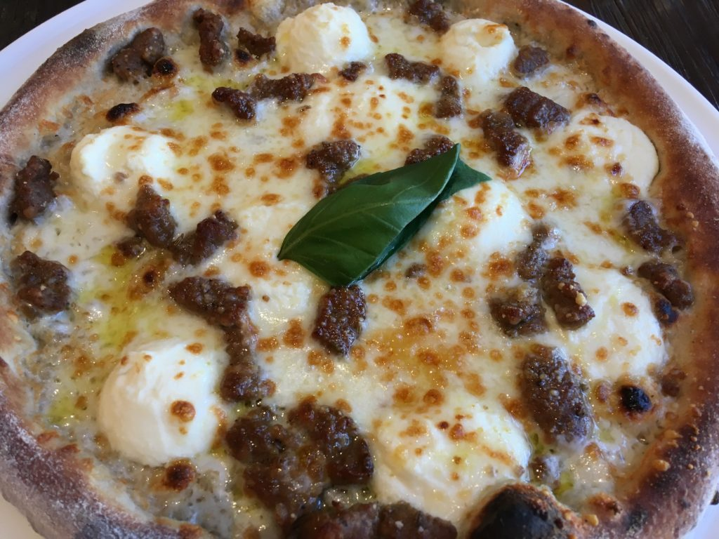 Pizzarino: Bianca Neve whole pie (white pizza with sweet sausage).