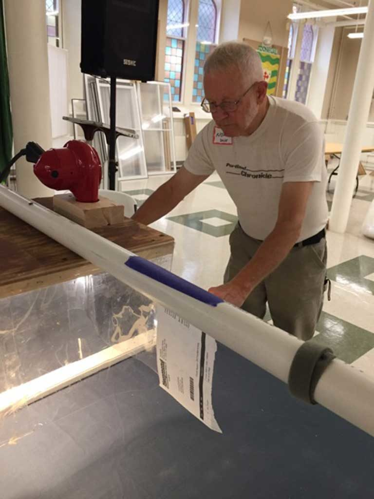 West End News - Volunteers crafting window inserts for their neighbors
