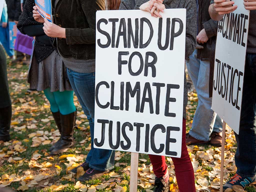 West End News - Climate Emergency - Stand up for climate justice sign