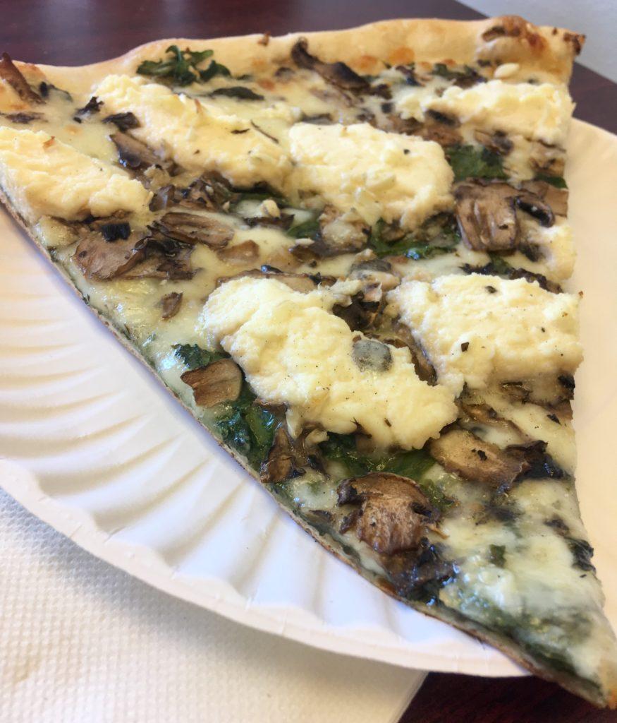 Pizzaiolo: slice of spinach, mushroom and ricotta pizza.