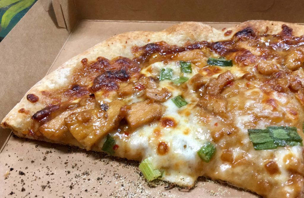 Pie in the Sky: slice of Thai chicken pizza.