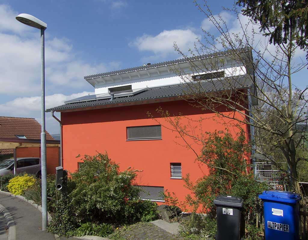 West End News - Bright Idea :Passive house with red facade in Germany