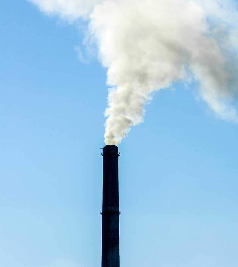 West End News - Smoke stack - Carbon fee and dividend