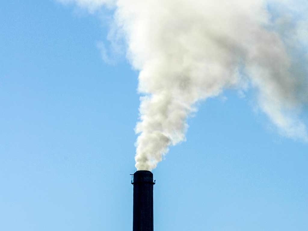 West End News - Stock image of smoke stack at coal power plant for article on racial justice and climate justice