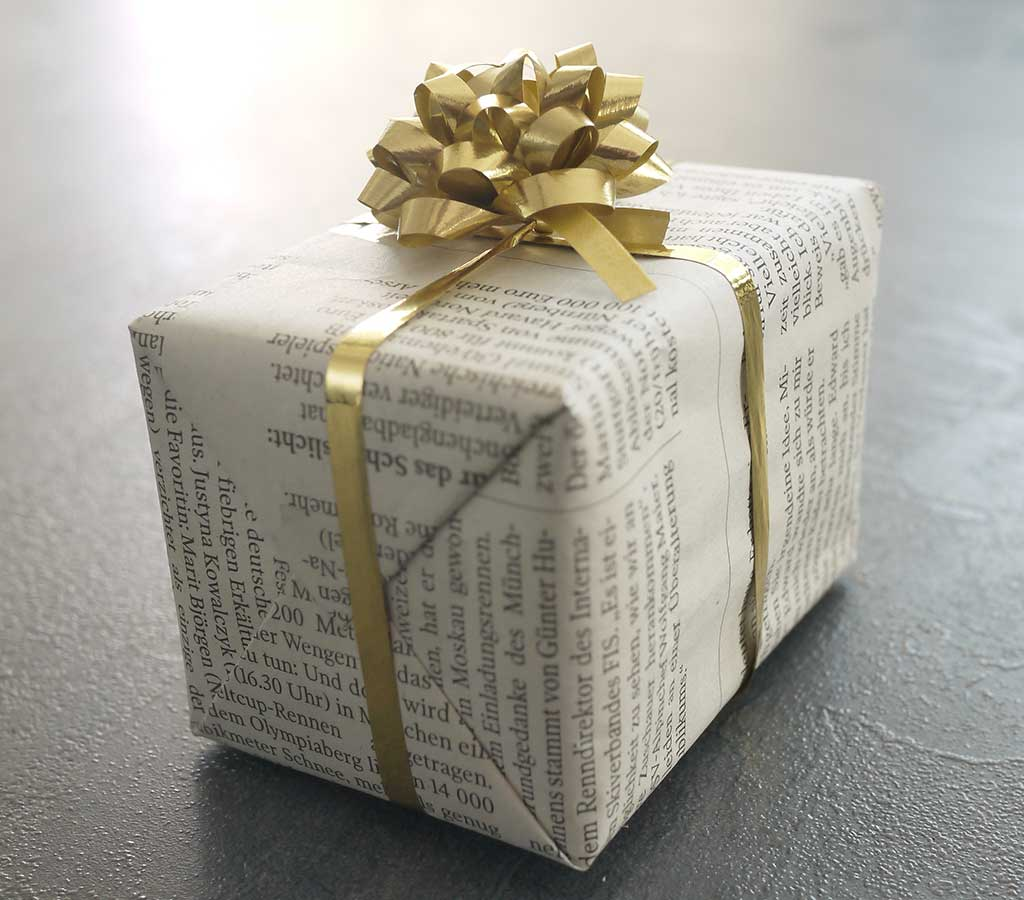 West End News - Zero-waste gift-wrapping - Newspaper wrapped gift - Adobe Stock