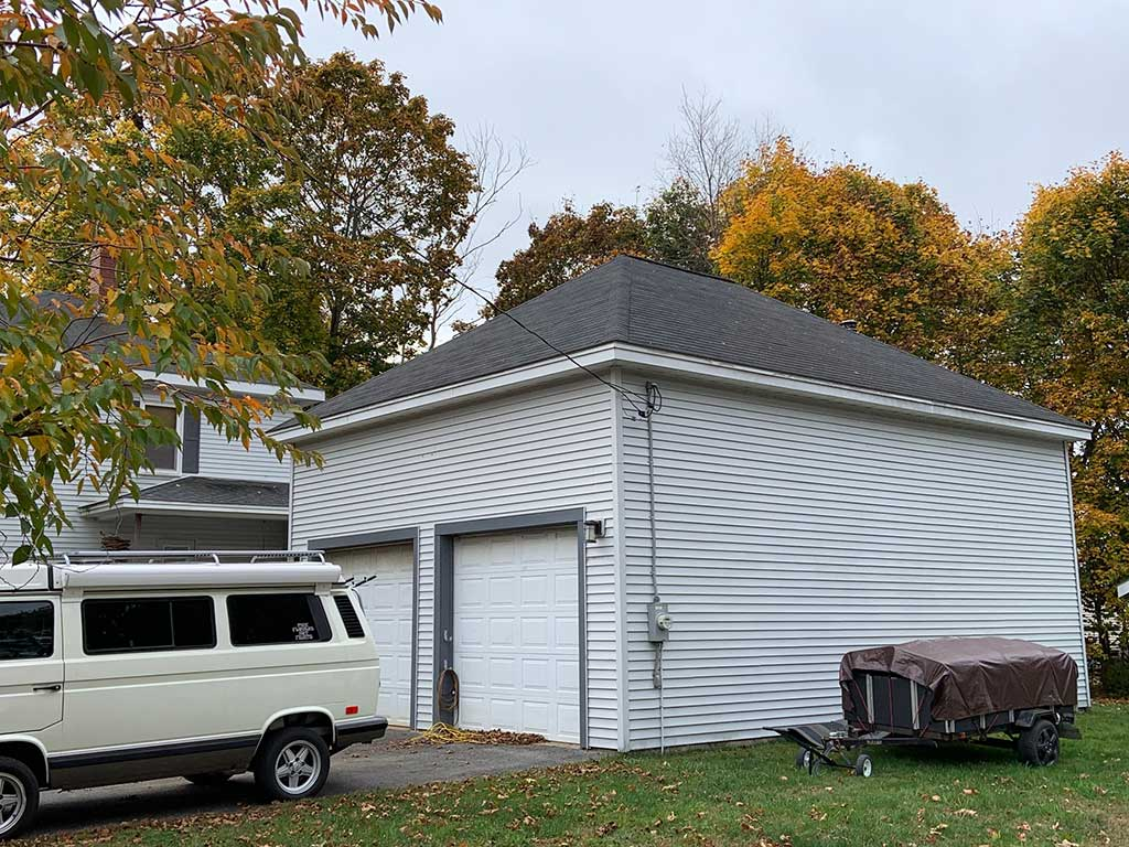West End News - Zoning for garages over people - Photo of 2-car garage by Zack Barowitz