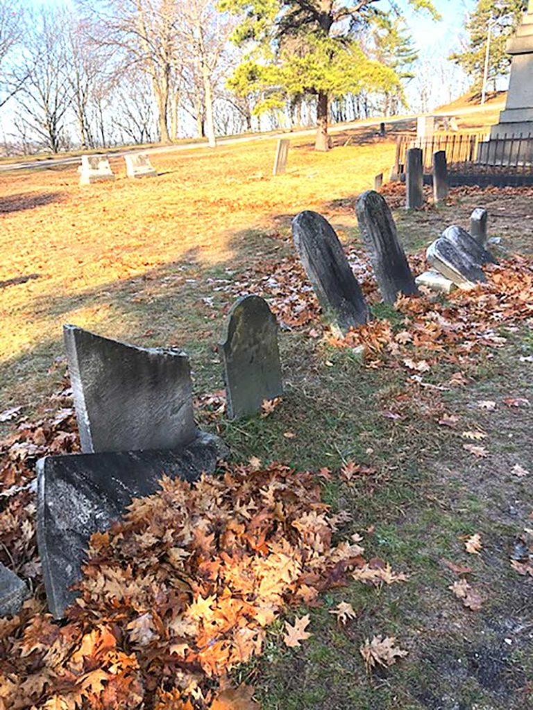 West End News - row of damaged grave markers