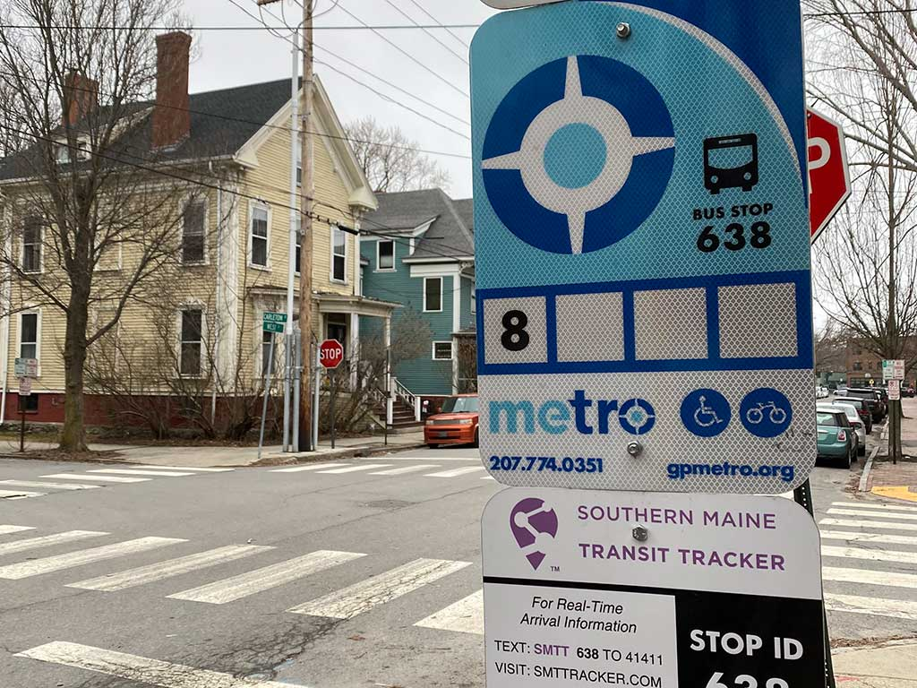West End News - Metro Route 8 bus stop sign