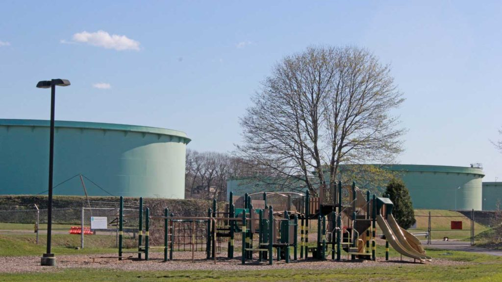 West End News - Fight for Clear Skies continues in South Portland - Here is a playground with storage tanks in background
