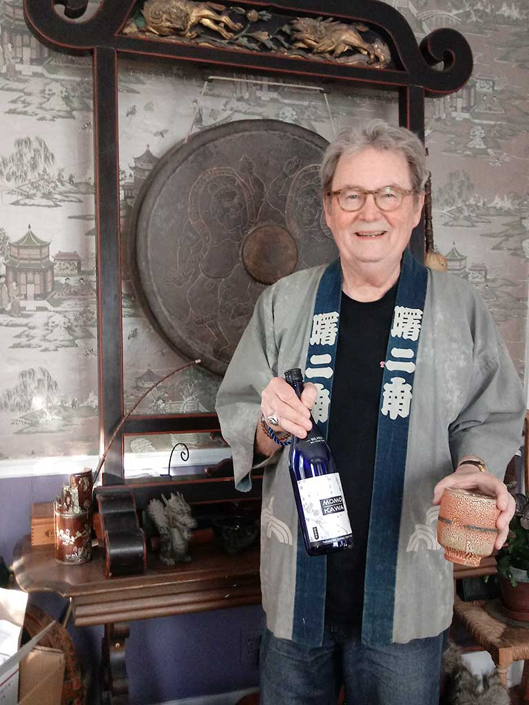 West End News - Layne V. Witherell pictured at home with gong, sake and kinomo
