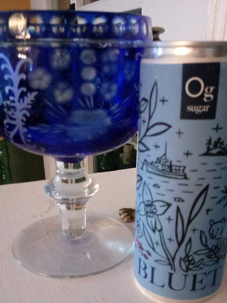 West End News - Can of Bluet and glass